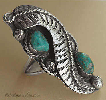 2 turquoises and a large sterling feather are on this Navajo old pawn ring