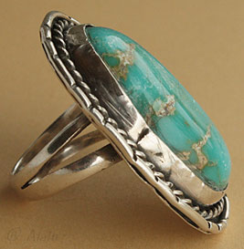Navajo ring with sterling silver rope around a turquoise