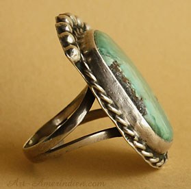 A green turquoise is serrated on this Navajo Indian ring