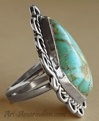 Navajo ring made from turquoise and sterling silver with ethnic symbols