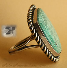 A green and gorgeous Arizona turquoise is serrated on this Navajo native american indian ring