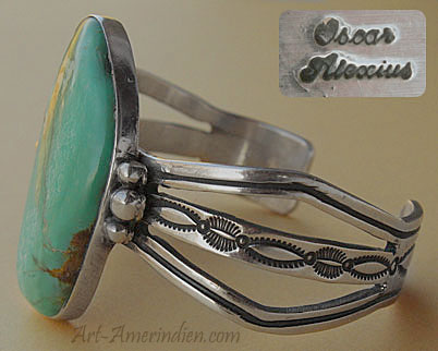 A gorgeous turquoise is serrated on this Indian Native American Navajo sterling bracelet signed Oscar Alexius