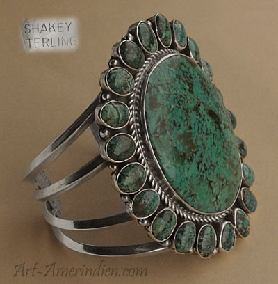 Navajo Indian Native American sterling silver and turquoises large bracelet with 22 green turquoises, hallmarked Robert Shakey