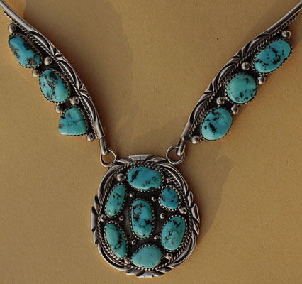 Navajo Indian Native american ethnic / tribal necklace, made from sterling silver, serrated turquoises, hallmarked Running Bear by Navajo silversmith