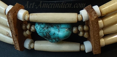 Indian choker necklace, 4 rows of buffalo bone beads, 1 turquoise gemm bead, leather spacers.